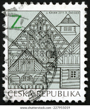 CZECH REPUBLIC - CIRCA 2011: post stamp printed in Czechoslovakia (Ceska) shows timber houses and cottage from bohemia; folk architecture � Z; black blue gray, circa 2011 - stock photo