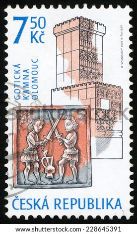 CZECH REPUBLIC - CIRCA 2007: stamp printed in Czechoslovakia (Ceska) shows gothic era stove & decorated tile with two fighting knights, Olomouc; historic stoves design; Scott 3349 7.50k, circa 2007 - stock photo