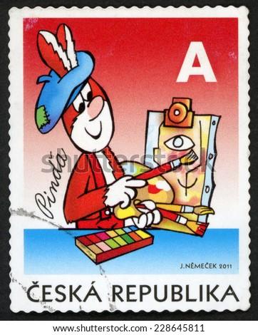 CZECH REPUBLIC - CIRCA 2011: stamp printed in Czechoslovakia (Ceska) shows illustration of Pinda rabbit as painter with brushes in hand & box of paints; ctyrlistek comic book; A red blue, circa 2011 - stock photo