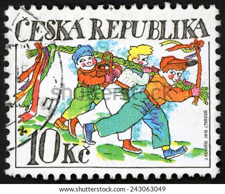 CZECH REPUBLIC - CIRCA 2010: stamp printed in Czechoslovakia (Ceska) shows symbols of Easter: three walking boys holding pussy willow whip (rod) & basket with painted eggs; 10k multicolor, circa 2010 - stock photo