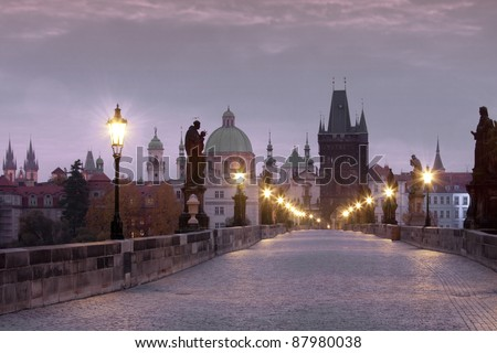 czech republic prague - charles bridge and spires of the old town at dawn - stock photo