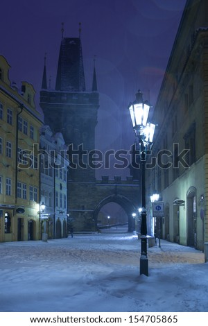 Czech Republic - Prague -  Charles Bridge in winter morning during snowfall - stock photo