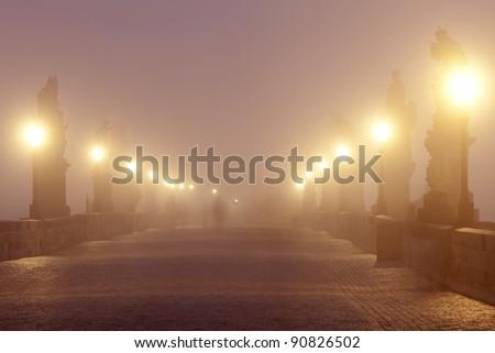 czech republic prague - charles bridge on foggy morning - stock photo