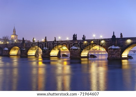 czech republic prague - illuminated charles bridge at dusk in winter - stock photo