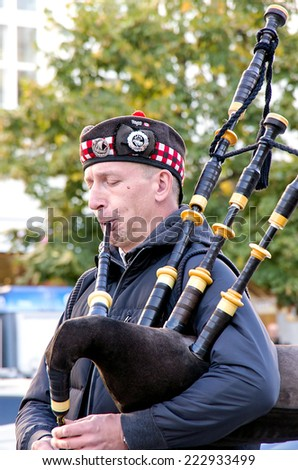 Czech Republic, Prague, October 3, 2014-Scottish bagpiper on Wenceslas Square in Prague - stock photo