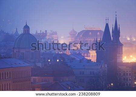 Czech Republic, Prague,  oldtown roofs during twilight - stock photo