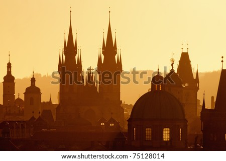 czech republic, prague - spires of the old town and tyn church at sunrise - stock photo