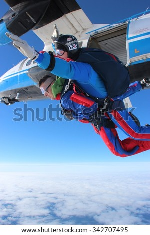 CZECH REPUBLIC, PRIBRAM, SEPTEMBER 11 2015. Skydiving photo. Parachute tandem jump with instructor. Czech republic, Pribram city, 2015.