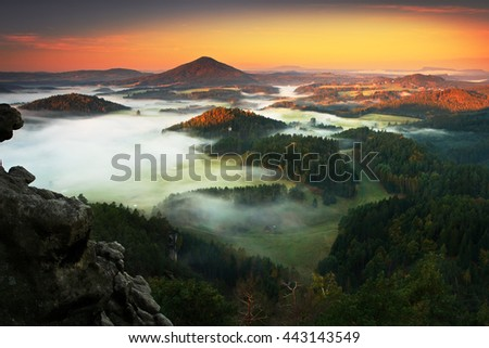 Czech typical autumn landscape. Hills and villages with foggy morning. Morning fall valley of Bohemian Switzerland park. Hills with fog, landscape of Czech Republic, landscape from Ceske Svycarsko.  - stock photo