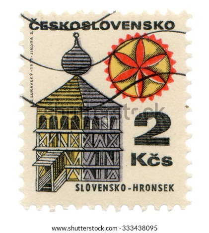 Czechoslovakia - about 1977: Postage stamp printed in Czechoslovakia, shows wooden clock tower in the village of Hronsek - stock photo