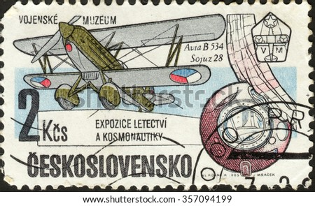"""CZECHOSLOVAKIA - CIRCA 1985: a post stamp printed in CZECHOSLOVAKIA shows a plane Sojuz-28, the series """"Exhibits from the Military Museum"""", circa 1985 - stock photo"""