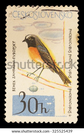 CZECHOSLOVAKIA - CIRCA 1964: A postage stamp printed in Czechoslovakia shows a common redstart, Phoenicurus phoenicurus, an european flycatcher with affinity with the robin, circa 1964 - stock photo