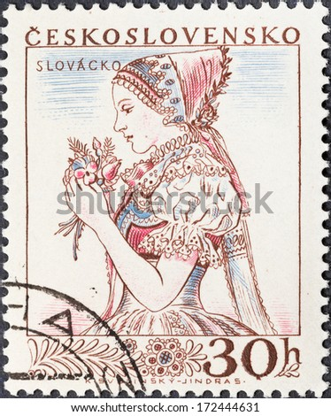 CZECHOSLOVAKIA- CIRCA 1956: A postage stamp printed in the Czechoslovakia shows portrait of young woman in Slovakian national costume, circa 1956 - stock photo