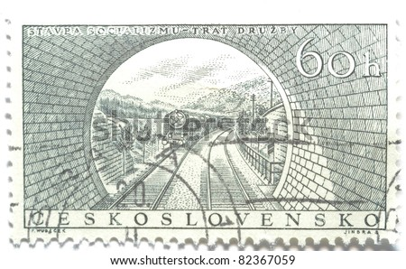 CZECHOSLOVAKIA - CIRCA 1955: a stamp from Czechoslovakia shows image of a train approaching a tunnel, circa 1955