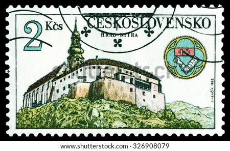 CZECHOSLOVAKIA  - CIRCA 1982: a stamp printed by Czechoslovakia, shows Nitra Castle and emblem, circa 1982 - stock photo