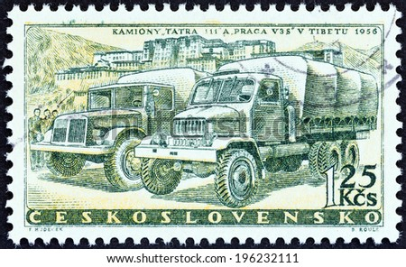 "CZECHOSLOVAKIA - CIRCA 1958: A stamp printed in Czechoslovakia from the ""Czech Motor Industry Commemoration "" issue shows Tatra III and Praga VS 3 Motor Trucks, circa 1958.  - stock photo"