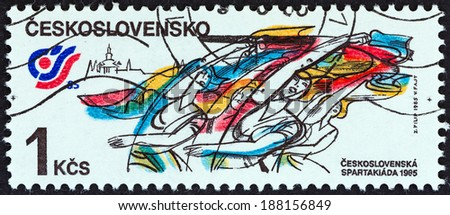 "CZECHOSLOVAKIA - CIRCA 1985: A stamp printed in Czechoslovakia from the ""National Spartakiad "" issue shows Gymnasts performing with ribbons, circa 1985.  - stock photo"