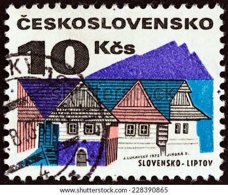 "CZECHOSLOVAKIA - CIRCA 1972: A stamp printed in Czechoslovakia from the ""Regional Buildings"" issue shows Wooden houses, Liptov, circa 1972.  - stock photo"