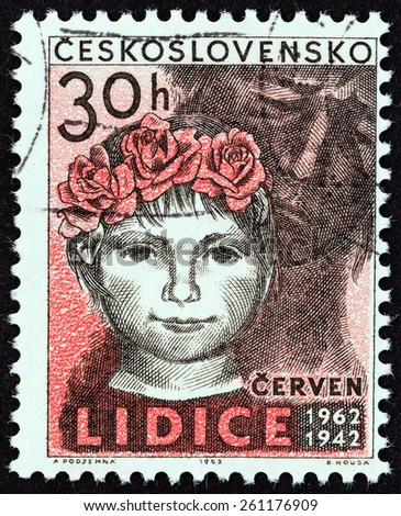 """CZECHOSLOVAKIA - CIRCA 1962: A stamp printed in Czechoslovakia from the """"20th Anniversary of Destruction of Lidice and Lezaky"""" issue shows girl of Lidice, circa 1962.  - stock photo"""