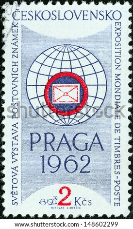 "CZECHOSLOVAKIA - CIRCA 1961: A stamp printed in Czechoslovakia issued for the ""PRAGA 1962"" International Stamp Exhibition (1st issue) shows Exhibition Emblem, circa 1961.  - stock photo"