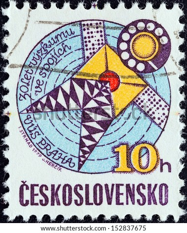 CZECHOSLOVAKIA - CIRCA 1979: A stamp printed in Czechoslovakia issued for the 30th anniversary of Telecommunications Research shows Stylized Satellite, circa 1979.  - stock photo