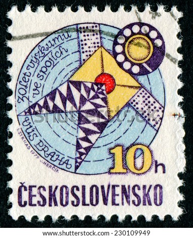 CZECHOSLOVAKIA - CIRCA 1979: A stamp printed in Czechoslovakia issued for the 30th anniversary of Telecommunications Research shows Stylized Satellite, circa 1979 - stock photo