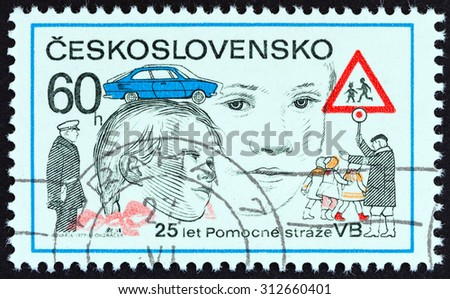 CZECHOSLOVAKIA - CIRCA 1977: A stamp printed in Czechoslovakia issued for the 25th anniversary of Police Aides Corps shows Children Crossing Road, circa 1977.  - stock photo
