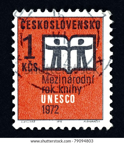 CZECHOSLOVAKIA - CIRCA 1972: A stamp printed in Czechoslovakia showing an open book with silhouette of two man to commemorate UNESCO International Year Book, circa 1972.