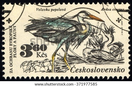 "CZECHOSLOVAKIA - CIRCA 1983: A stamp printed in Czechoslovakia shows a Grey herons with the inscription ""Ardea cinerea"", series animals, circa 1983 - stock photo"