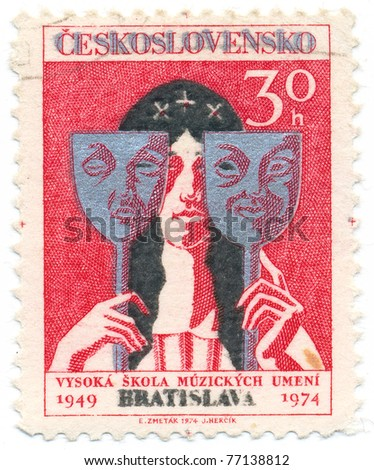 CZECHOSLOVAKIA - CIRCA 1974: A stamp printed in Czechoslovakia, shows actress holding tragedy and comedy masks, circa 1974 - stock photo