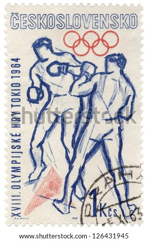 CZECHOSLOVAKIA - CIRCA 1963: A stamp printed in Czechoslovakia, shows boxers fight, devoted to Olympics in Tokyo, series, circa 1963