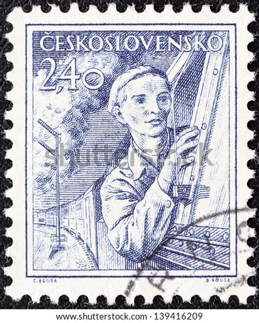 CZECHOSLOVAKIA - CIRCA 1954: A stamp printed in Czechoslovakia shows engine driver, circa 1954. - stock photo