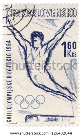 CZECHOSLOVAKIA - CIRCA 1963: A stamp printed in Czechoslovakia, shows flying gymnast, devoted to Olympics in Tokyo, series, circa 1963