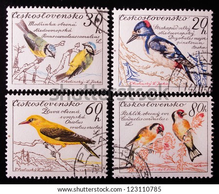 CZECHOSLOVAKIA - CIRCA 1959: A stamp printed in Czechoslovakia  shows four kinds of sitting colorful birds , circa 1959. - stock photo