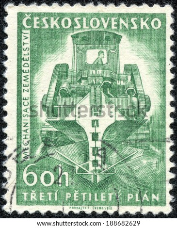 CZECHOSLOVAKIA - CIRCA 1961: A Stamp printed in Czechoslovakia shows image of ditch digging machine (Mechanisace Zemedelstvi), circa 1961 - stock photo