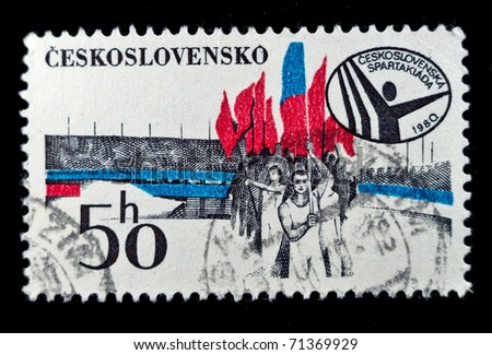 CZECHOSLOVAKIA - CIRCA 1980: A stamp printed in Czechoslovakia shows image of gymnasts in the largest stadium in the world in Prague, the Spartakiada Stadium, circa 1980
