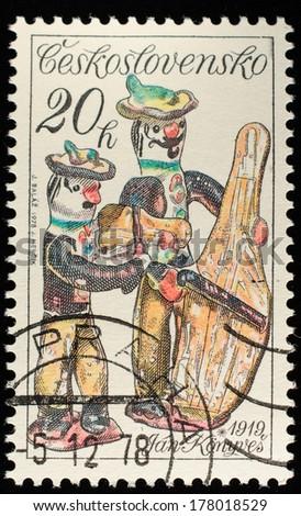 "CZECHOSLOVAKIA - CIRCA 1978: A stamp printed in Czechoslovakia, shows porcelain figurine musicians"", from the series ""Slovak Ceramics"", circa 1978  - stock photo"