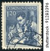 CZECHOSLOVAKIA - CIRCA 1954: A stamp printed in Czechoslovakia, shows Scientist and microscope, series, circa 1954 - stock photo