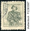 CZECHOSLOVAKIA - CIRCA 1954: A stamp printed in Czechoslovakia, shows soldier with a gun, series, circa 1954 - stock photo