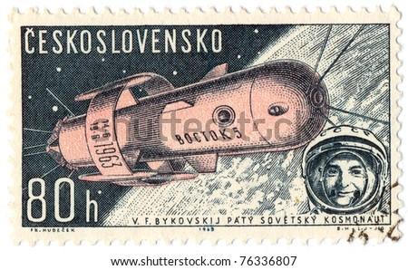 "CZECHOSLOVAKIA - CIRCA 1962: A stamp printed in Czechoslovakia, shows Soviet spaceship ""VOSTOK-2"" , circa 1962 - stock photo"