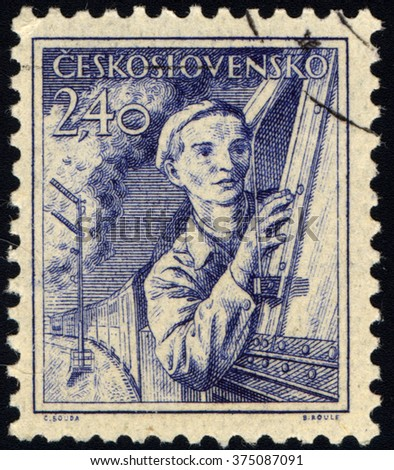 CZECHOSLOVAKIA - CIRCA 1954: A stamp printed in Czechoslovakia shows Woman Engine Driver, circa 1954 - stock photo