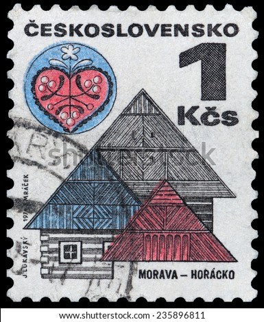 CZECHOSLOVAKIA - CIRCA 1971: a stamp printed in Czechoslovakia shows wooden houses in Horaco, Moravia, circa 1971 - stock photo