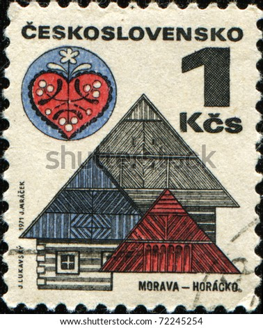 CZECHOSLOVAKIA - CIRCA 1971: a stamp printed in Czechoslovakia shows wooden houses in Horaco, Moravia, circa 1971