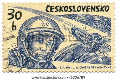 "CZECHOSLOVAKIA - CIRCA 1964: A stamp printed in Czechoslovakia, shows Yuri Gagarin and Soviet spaceship ""VOSTOK-1"", circa 1964 - stock photo"