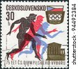 CZECHOSLOVAKIA -CIRCA 1971: A stamp printed in the Czechoslovakia, dedicated to 75th anniversary of Czechoslovak Olympic Committee, is shown Runners, Parthenon, Czechoslovak Olympic Emblem, circa 1971 - stock photo