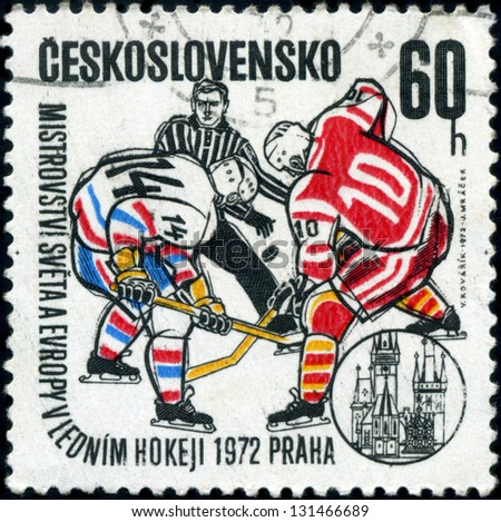 CZECHOSLOVAKIA - CIRCA 1972: A stamp printed in the Czechoslovakia, dedicated to World and European Ice Hockey Championships, Prague, shows two hockey player and hockey referee, circa 1972 - stock photo