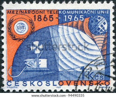 CZECHOSLOVAKIA - CIRCA 1965: A stamp printed in the Czechoslovakia, is dedicated to the 100th anniversary of the ITU, shows the ITU Emblem and Communication Symbols, circa 1965 - stock photo