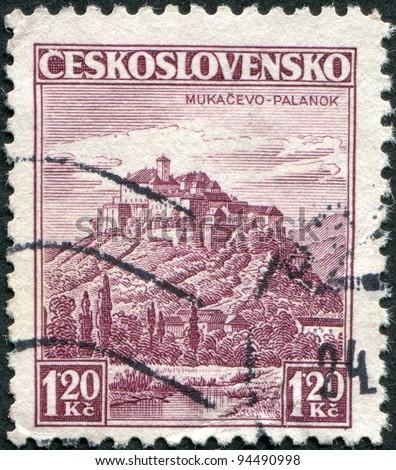 CZECHOSLOVAKIA - CIRCA 1936: A stamp printed in the Czechoslovakia, represented Castle Palanok near Mukacevo, circa 1936 - stock photo