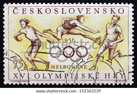 CZECHOSLOVAKIA - CIRCA 1956: a stamp printed in the Czechoslovakia shows Athletes and Olympic Rings, Summer Olympics, Melbourne, 1956, circa 1956 - stock photo