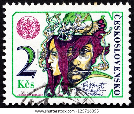 CZECHOSLOVAKIA - CIRCA 1976: a stamp printed in the Czechoslovakia shows Couple Smoking, WHO Emblem and Skull, Fight against Smoking and Drug Addiction, circa 1976 - stock photo